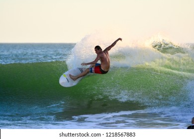 CA, 2018 a tourist surfing in Iguana Beach. Tola, Rivas, Nicaragua.
