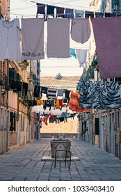 Ca Nova calle with hanhing clothes in Venice, Italy. Typical view.