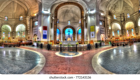 Caacupe, Paraguay - November 13, 2017: Vertical panorama of the interior of the cathedral Basilica de la Virgen de los Milagros in Caacupe-Paraguay.