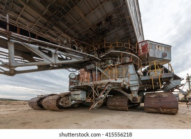 Cab and career caterpillar excavator. Many buckets of giant quarry excavator Equipment for the extraction of sand from the quarry.