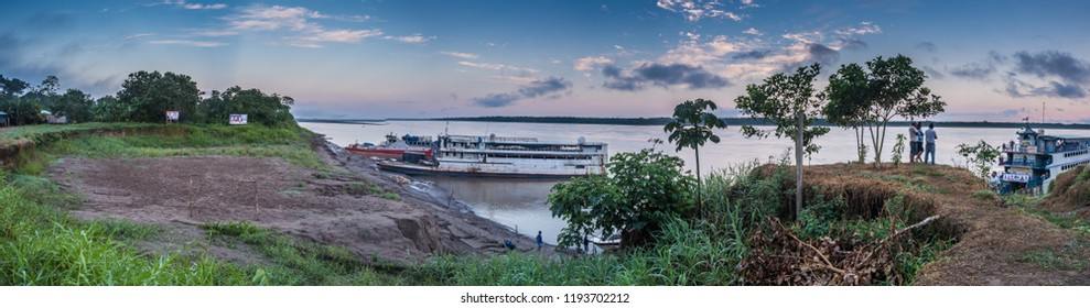 Caballococha, Peru - Sep 23, 2018: Cargo boat in the port on the Amazon river near Caballococha village. Boat cannot go to the town as the level of water is very low