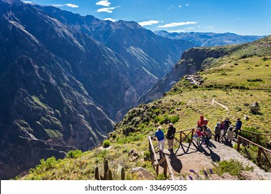 CABANACONDE, PERU - MAY 13, 2015: Unidentified tourists at the Cruz Del Condor viewpoint.
