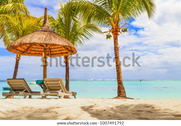 Cabanas with loungers on the beach