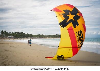 Cabarete / Dominican Republic - December 6 2017: Kiteboarders practice on famous Cabarete Beach in Dominican Republic.