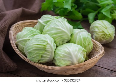 Cabbage in basket on wooden table