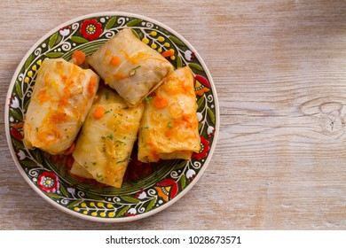 Cabbage rolls with beef, rice and vegetables. Stuffed cabbage leaves with meat. Dolma, sarma, sarmale, golubtsy or golabki. View from above, top, horizontal