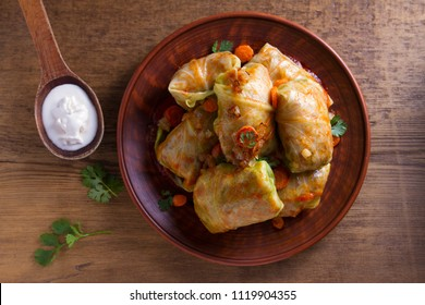 Cabbage rolls with meat, rice and vegetables. Stuffed cabbage leaves with meat. Chou farci, dolma, sarma, golubtsy or golabki. View from above, top studio shot
