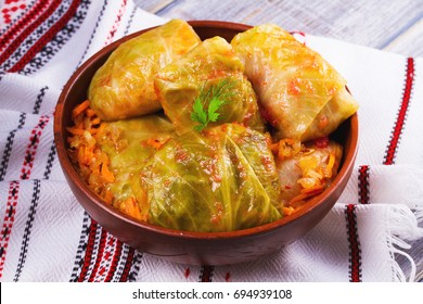 Cabbage rolls with meat, rice and vegetables. Stuffed cabbage leaves with meat. Dolma, sarma, sarmale, golubtsy or golabki - traditional and popular dish in many countries