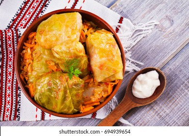 Cabbage rolls with meat, rice and vegetables. Stuffed cabbage leaves with meat. Dolma, sarma, sarmale, golubtsy or golabki. View from above, top studio shot