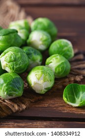 cabbage sprouts on wooden surface