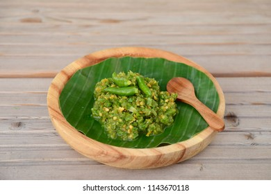 Cabe Ijo. Traditional Indonesian green chili paste on banana leaf, place on wooden background