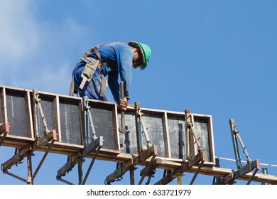 Cabedelo, Paraiba, Brazil - May 4, 2017 - Construction worker working on top of construction site on a sunny day