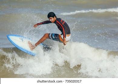 Cabedelo, Paraiba, Brazil - October 15, 2017 - Surfer on the wave