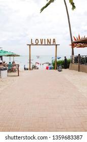 Cabedelo - PB, Brazil - February 23, 2019: Lovina Tropical bar and restaurant. View from the restaurant to the beach. Beachfront restaurant at Ponta de Campina.