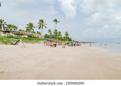 Cabedelo - PB, Brazil - February 23, 2019: Local people and tourists enjoying the day at Ponta de Campina beach in front of Lovina Tropical bar and restaurant. Northeastern Brazilian beach.