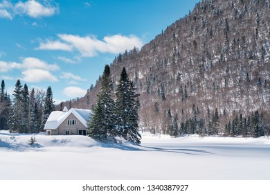 cabin covered in snow in Parc National de la Jacques-Cartier