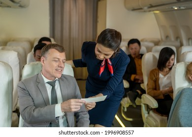 Cabin crew or air hostess takes care of passengers in planes,Airline transportation and tourism concept.