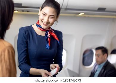 Cabin crew or Stewardess greeting passengers on airplane, Air hostess or stewardess service