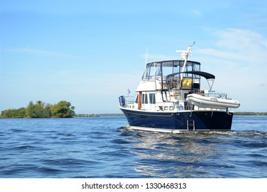 cabin cruiser boat out on the river heading to the ocean