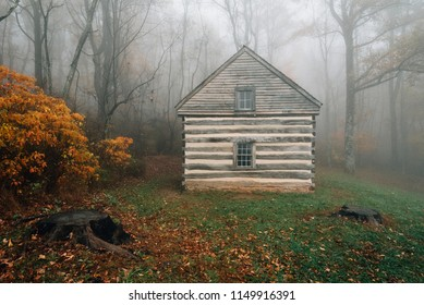 Cabin in fog and autumn color at Peaks of Otter, on the Blue Ridge Parkway in Virginia.