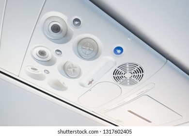 Cabin inside the plane, air condition, lights and signs panel above the seat