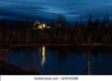 Cabin with a lantern on the lakeside in the night, September 27, 2018, Norilsk