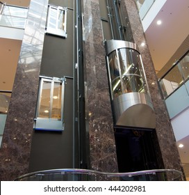 The cabin is modern elevator in the lobby of the building