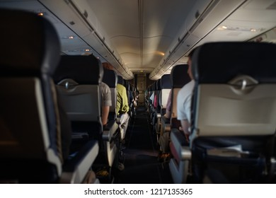 Cabin Of A Passenger Plane Filled With People