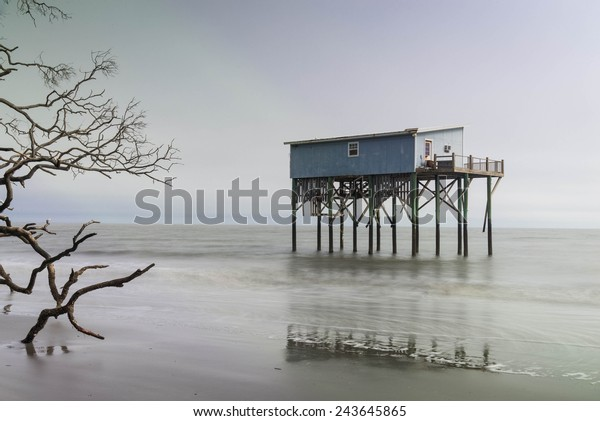 A cabin still stands where there used to be land on Hunting Island State Park in Beaufort, South Carolina