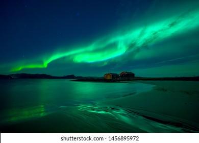 Cabin under Northern light in Norway