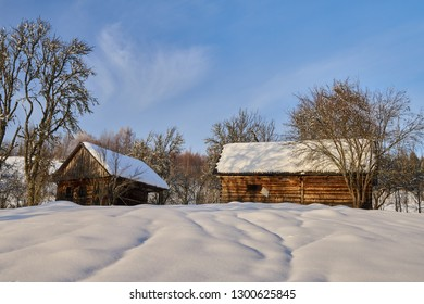Cabin in the woods, a house covered in snow by the pine forest
