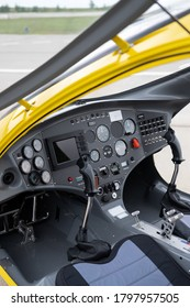 The cabin of the yellow gyroplane in the parking lot