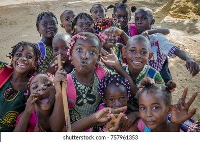 CABINDA, ANGOLA - APRIL 16 2014: Unidentified young African children with beautifully decorated hair making faces