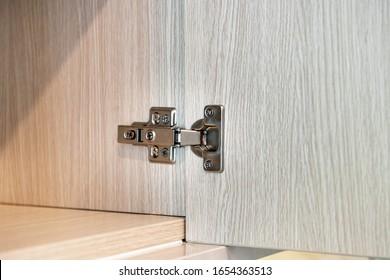 Cabinet door hinges in a cupboard close-up