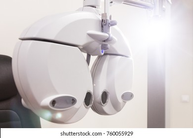the cabinet of the eye doctor. automatic phoropter for the selection of lenses.