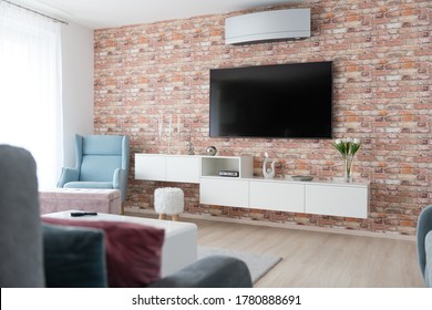 Cabinet and TV in living room of modern house