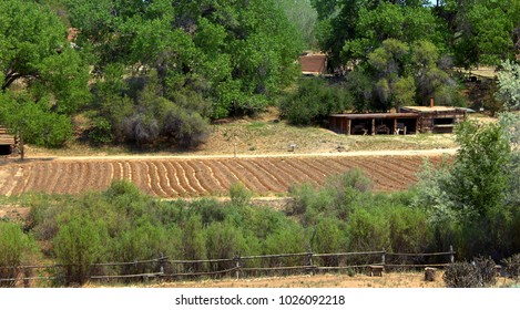 Cabins and garden are part of the El Rancho del las Golondrinas ranch.  It is a living museum teaching about the culture and heritage of early New Mexico.