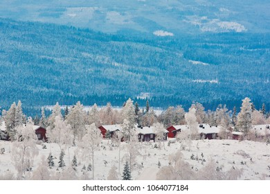 Cabins in the winter and snowy landscape in the Swedish forest with a view