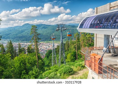 Cablaway with cable car in Piatra Neamt , Romania,  arriving on top of mountain