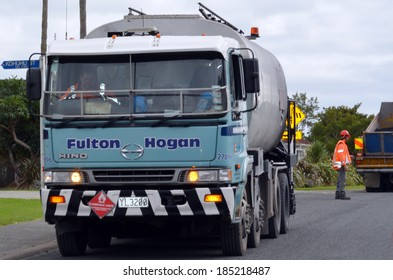 CABLE BAY, NZ - APR 01 2014:Fulton Hogan roadwork.Fulton Hogan is a large infrastructure construction, roadworks company in NZ and Australasia.In 2013 it's annual operating profit was NZ$96.5 million.