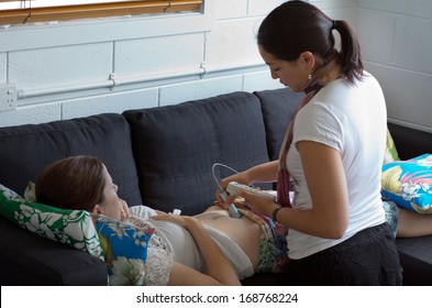 CABLE BAY,NZ:Midwife checks baby heart beat and movement on Dec 12 2013.Midwifery is a health care profession in which providers offer care to women during pregnancy,labor ,birth and postpartum.