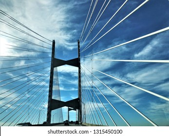 Cable bridge across St.Johns River on the blue sky white clouds and the sunlight, Winter in Jacksonville, Florida USA.