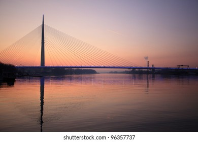 cable bridge in red sunset