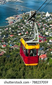 Cable car above Tromso city with the bridge and Arctic Cathedral on background, Norway