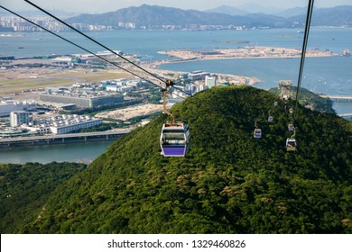 Cable car with airport in background,  Hong Kong China