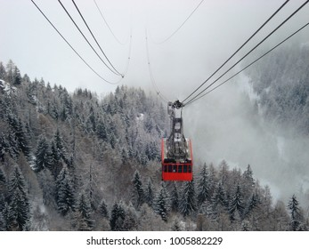 Cable car appearing through the clouds and mist