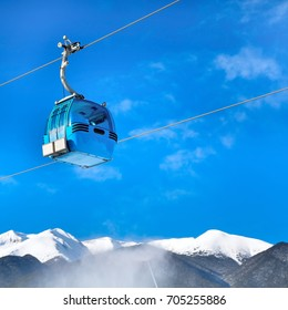 cable car cabin in Bansko, Bulgaria and snow mountain peaks at the background