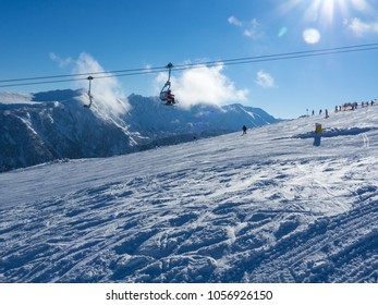 Cable car cabin in Bansko and snow mountain peaks at the background. Blue sky, 2017. Bansko ski and snowboard resort in Bulgaria.