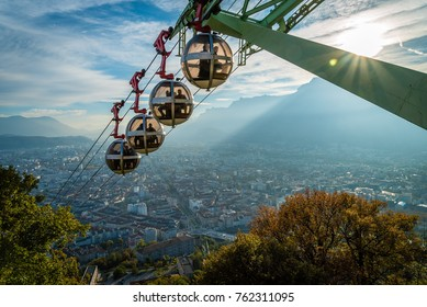 Cable car descending La Bastille hill in Grenoble in France with a nice sunset in the background