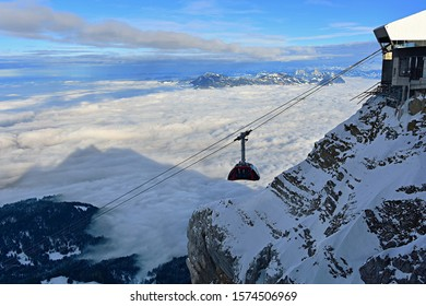 The cable car Dragon Ride at mount Pilatus and the sea of mist.